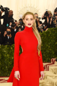 NEW YORK, NY - MAY 07: Amber Heard attends the Heavenly Bodies: Fashion & The Catholic Imagination Costume Institute Gala at The Metropolitan Museum of Art on May 7, 2018 in New York City. (Photo by Jamie McCarthy/Getty Images)